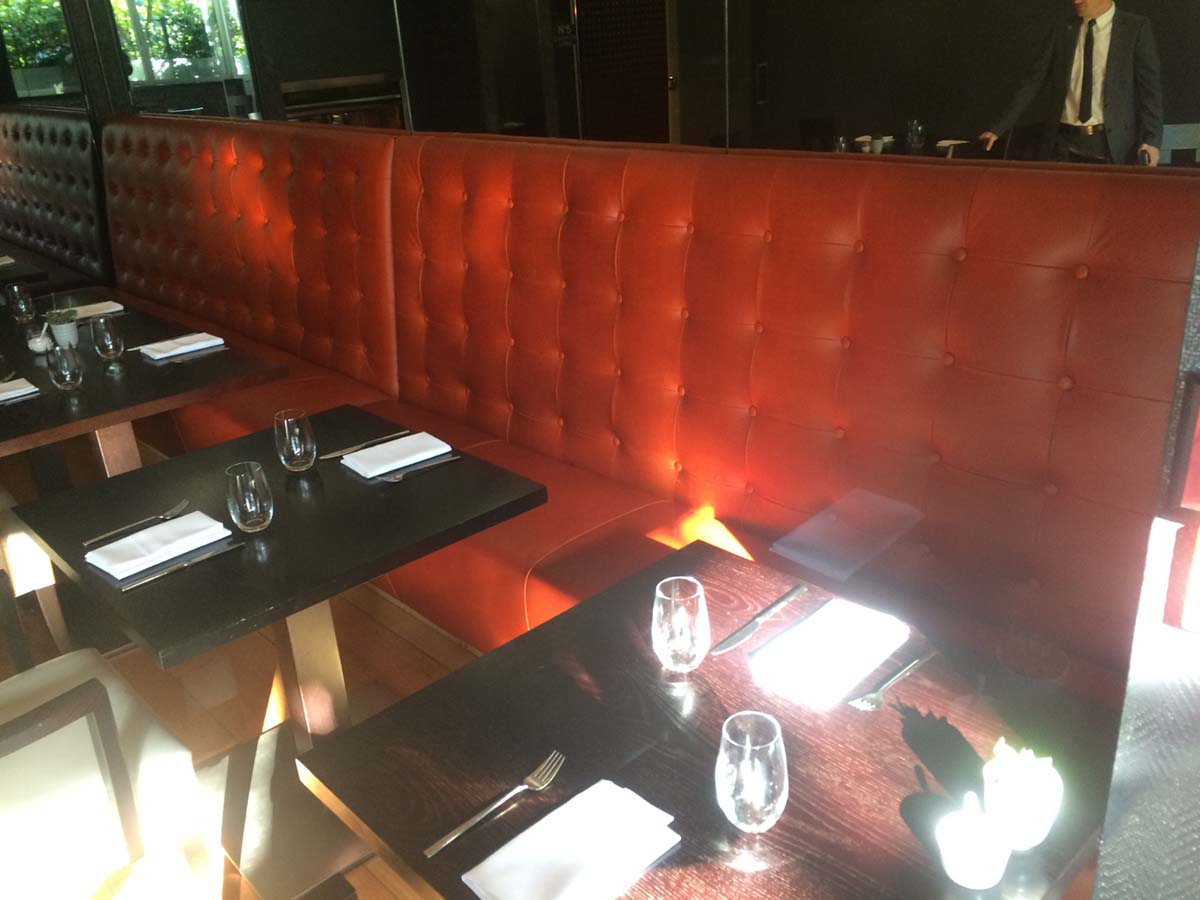 Seating in No 5 Reastaurant, The Spire Hotel Recovered in Deep Orange Leather