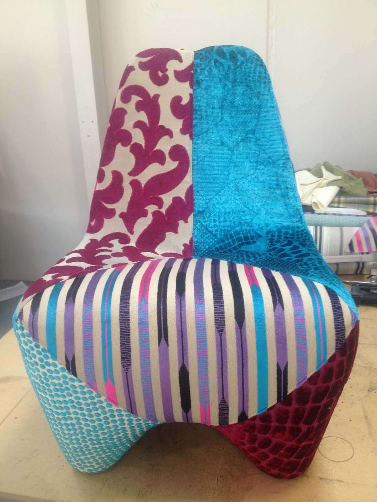 Using scraps of fabric to recover this Italian style chair for an Aspen Grove client