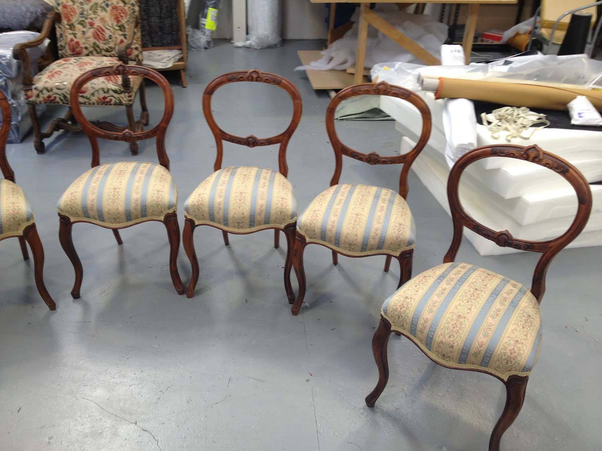 Set of 8 dining chairs which were all battered and broken fully repaired, polished and covereed in a Regent Stripe fabric