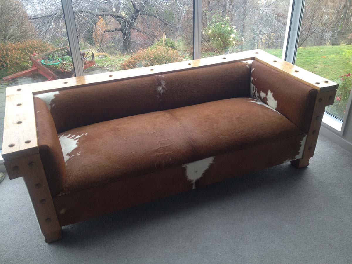Old style couch covered in Cowhide for Tim Wilson, Artist